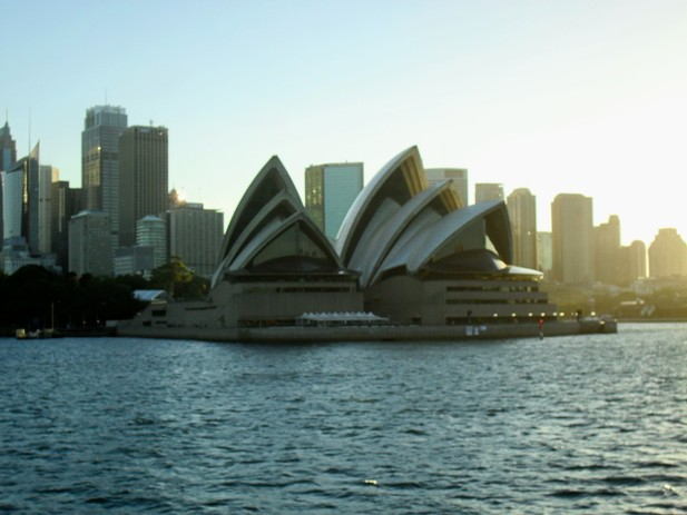 A view of the Sydney Opera House from across the harbour in the evening sun