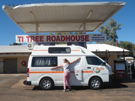 Hugging a campervan as it is filled up with petrol at a roadhouse in Ti Tree in the Northern Territory