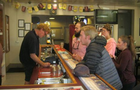 Backpackers ordering drinks at a local outback pub