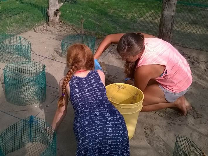 Two girls working in the turtle hatchery in Costa Rica