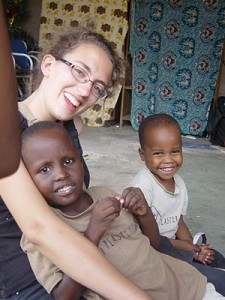 Volunteer laughing and playing with kids in Tanzania