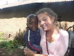 Oyster volunteer hugging a Tanzanian child