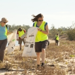 Volunteers collecting rubbish from a beach site in Western Australia