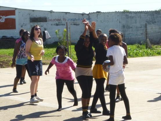 Oyster volunteer coaching netball in Port Elizabeth