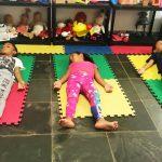 Volunteer monitors nap time