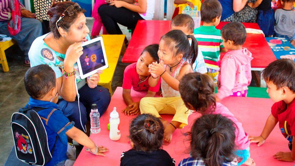 volunteer with children in a classroom