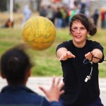 A volunteer in South Africa coaches netball in the townships