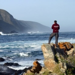 Volunteer sports coach looks out over the stunning views in South Africa