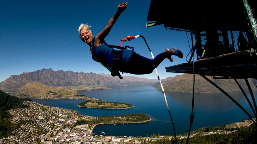 Girl bungee jumping out of a plane