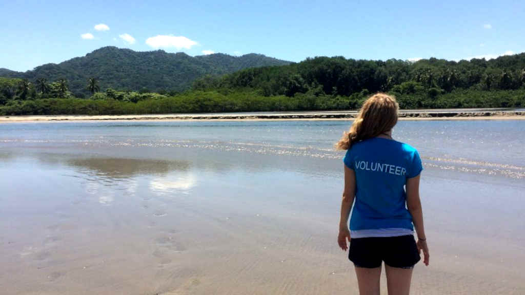 A volunteer looks out over the beach in Costa Rica
