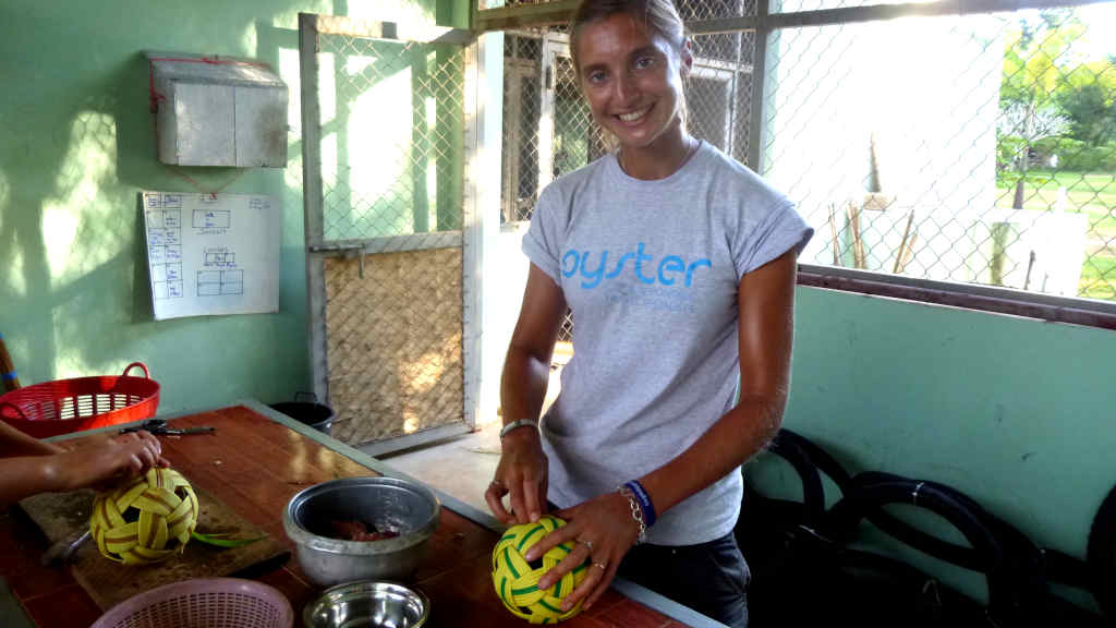 A volunteer creates enrichments for animals at the sanctuary