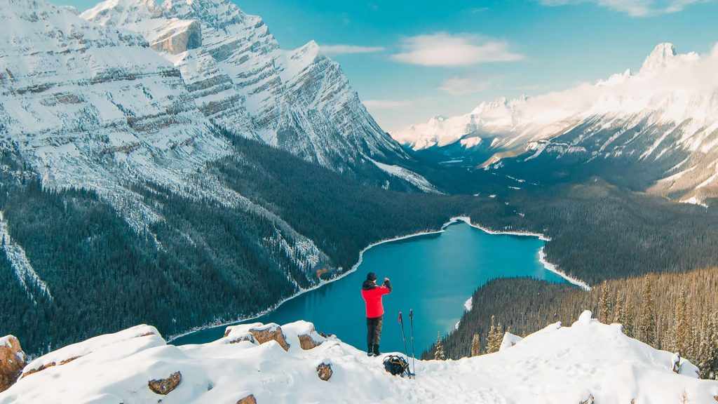 A hiker enjoys the stunning view over Peyto Lake in Banff National Park