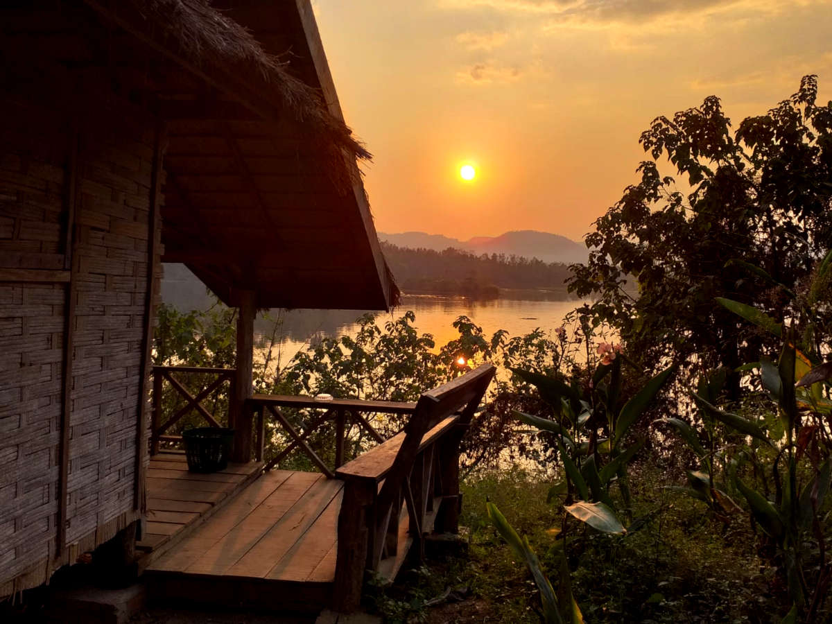 The sun sets over the lake at the elephant volunteering project in Laos