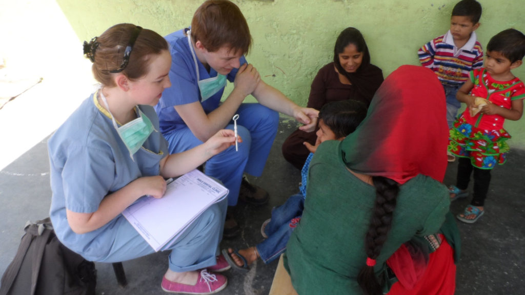 Interns working at a dental camp in northern India