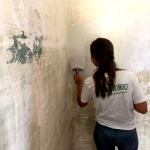 A volunteer helps to renovate a house in Portugal