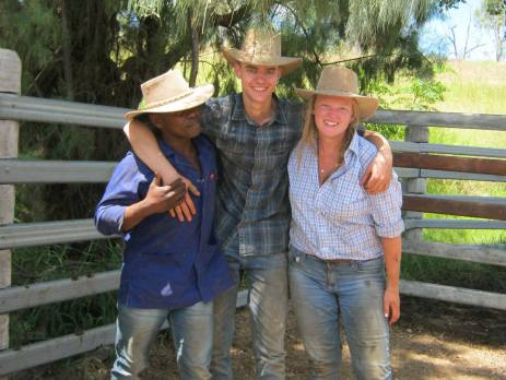 Three trainees smiling at the camera wearing work hats in Australia and shading themselves from the hot Australian sun.
