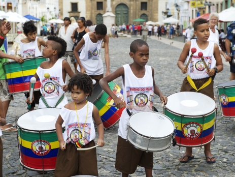 Ecuador children playing drums in the street