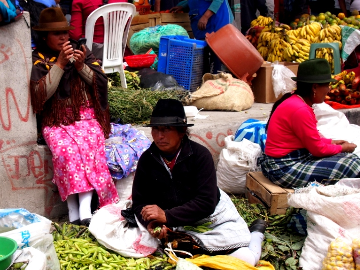 The local women sell their wares in local markets in Ecuador
