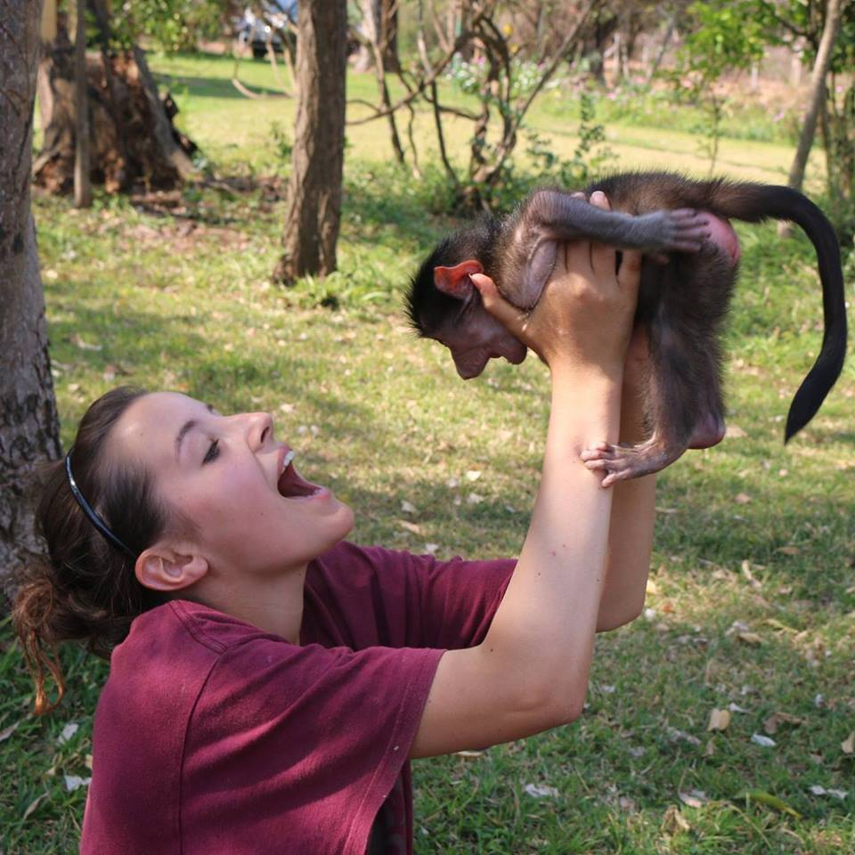 Oyster volunteer with monkey in South Africa