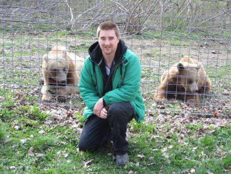 Luke Wililams, a volunteer in Romania, posing with a couple of the resident brown bears.