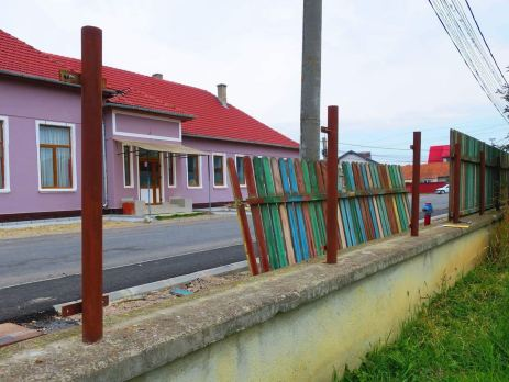 The fence outside a children's home in Romania, in desperate need of repair. Childcare volunteer Victoria decided to fundraise to replace the fence.
