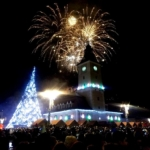 Fireworks go off over Brasov town square to welcome in 2018.