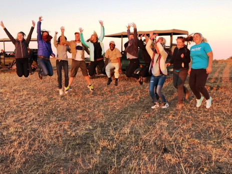 group jumping at the game reserve with oyster volunteers in south africa