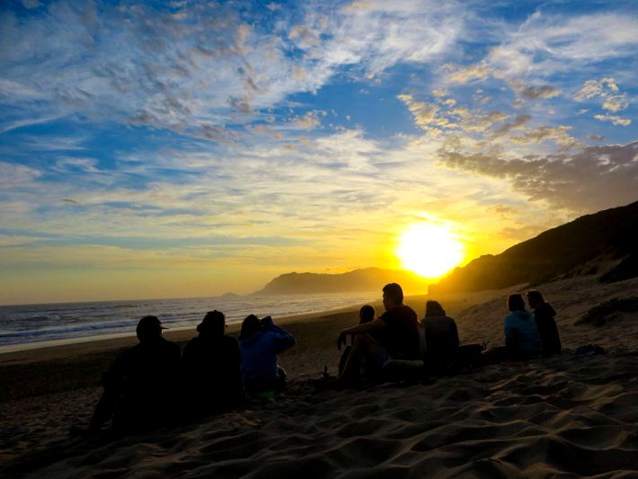 Travellers watch an amazing sunset on the Garden Route Adventure Tour