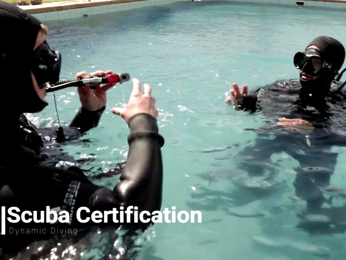 A participant learns to dive in South Africa
