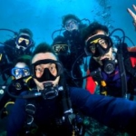 Volunteers pose for a selfie whilst diving in Thailand