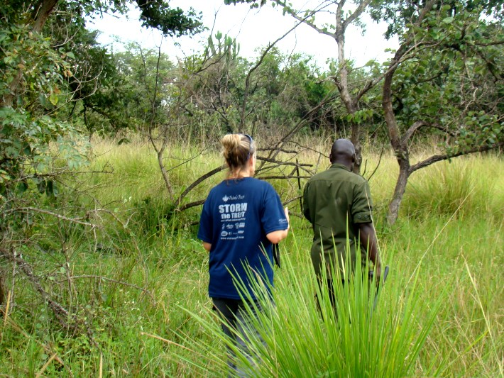 A volunteer and ranger track rhinos at the sanctuary in Uganda