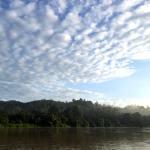 The sun rises over the Kinabatangan River