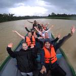 Volunteers on a boat in the Kinabatangan river, helping to monitor wildlife