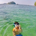 Turtle conservation volunteer gets ready to go and do some snorkelling on the reef