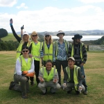 Conservation volunteers in Australia celebrate their work well done