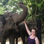 A volunteer enjoys meeting rescued elephants in Thailand