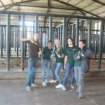 Volunteers cleaning out the elephant enclosures in South Africa