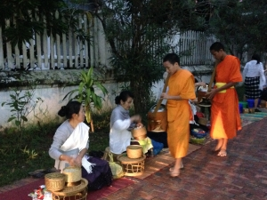 Monks taking alms in the UNESCO city of Luang Prabang