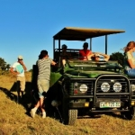 Volunteers on jeep patrol at Kwantu game reserve, South Africa