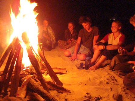 Enjoying an evening around the camp fire while rafting