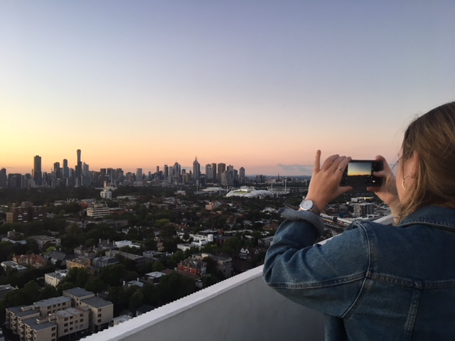Girl taking a photo of the Melbourne Skyline