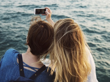 Two girls taking a selfie whilst travelling