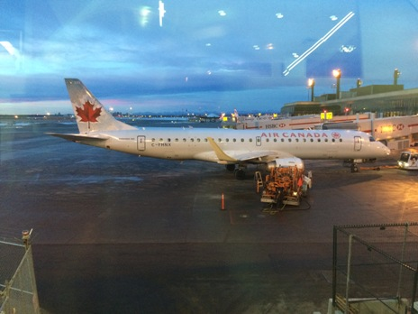 Photo of an Air Canada plane at the airport. Combat jet-lag on the plane and prepare yourself for when you arrive into the country.