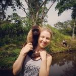 A volunteer with a monkey in Ecuador