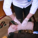 Volunteer bandaging a leg