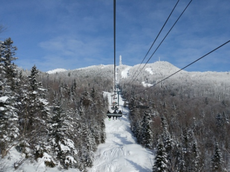 Tremblant Quebec chairlift up the mountain in snowy conditions